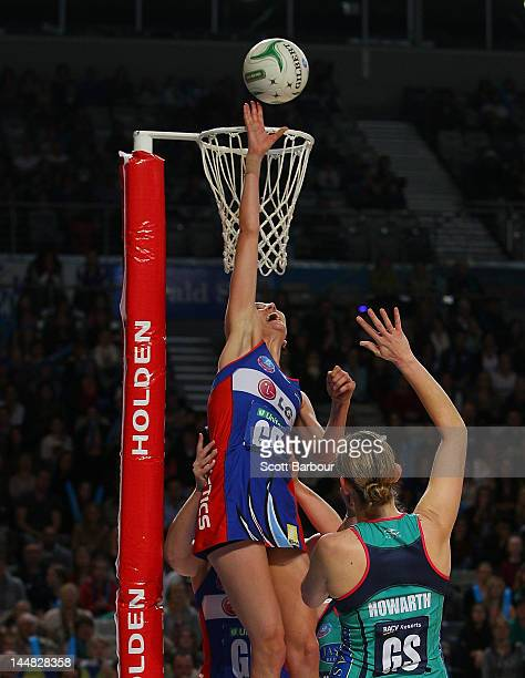 Anna Harrison of the Mystics blocks the shot of Karyn Howarth of the Vixens during the round eight ANZ Championship match between the Melbourne...