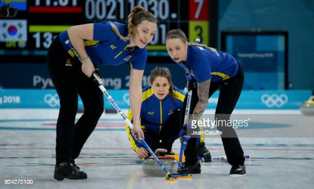 Anna Hasselborg of Sweden between Anna Knochenhauer and Sofia Mabergs during the Women's Gold Medal game between Sweden and South Korea at the 2018...