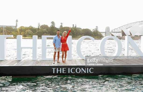 Anna Heinrich and Tim Robards pose on floating runway ahead of THE ICONIC Swim Show 2017 on November 30 2017 in Sydney Australia