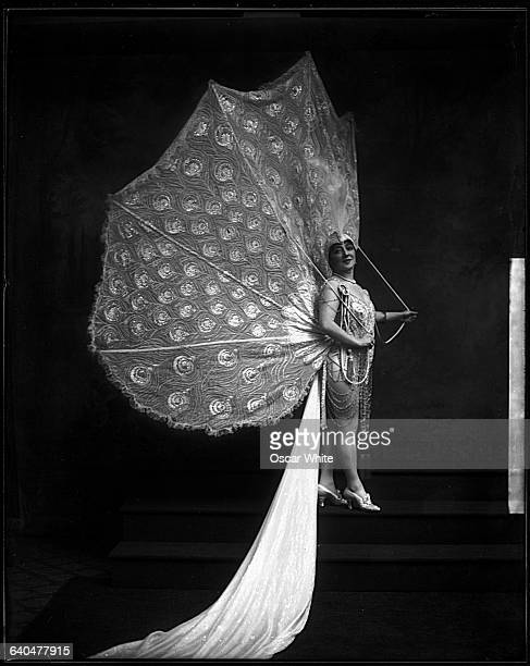 Anna Held Ziegfield's wife and star poses for a portrait in a peacock costume