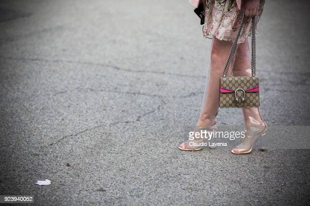 Anna Hilltrop fashion detail Perspex heels and Gucci bag are seen outside Missoni show during Milan Fashion Week Fall/Winter 2018/19 on February 24...