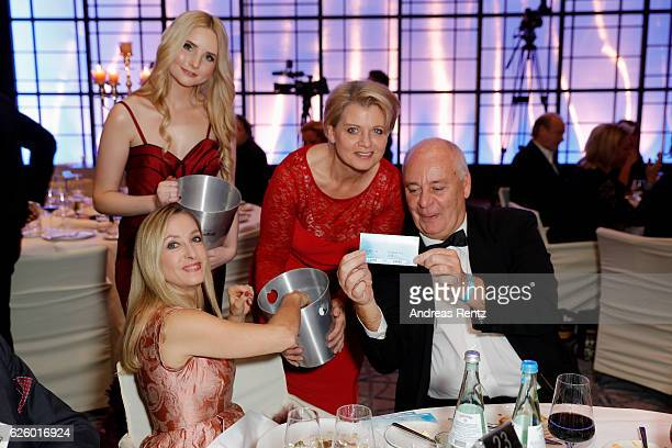 Anna Hiltrop and Andrea Spatzek sell loose during the charity event dolphin aid gala 'Dolphin's Night' at InterContinental Hotel on November 26 2016...