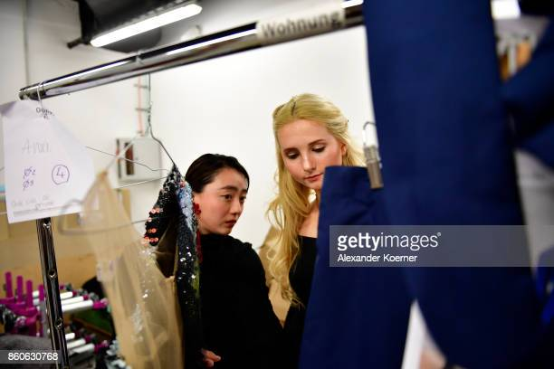 Anna Hiltrop and Designer WenTing Cheng take a closer look to an outfit prior walking the runway during the American Women's Club And Esmod Charity...