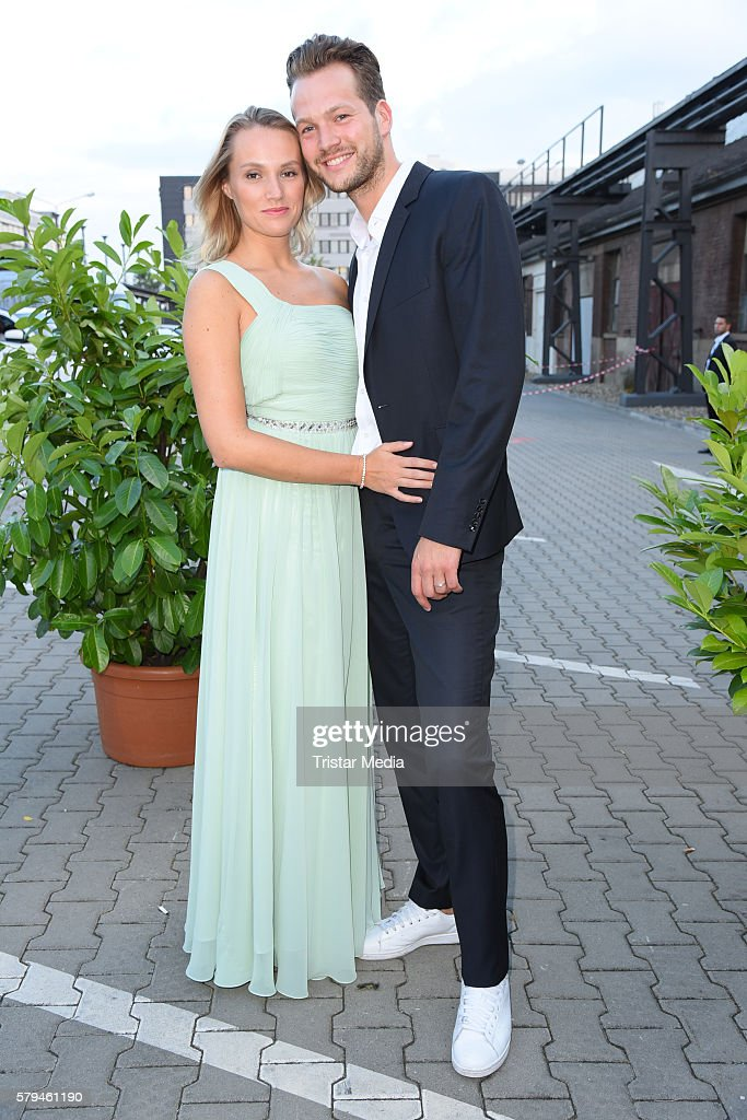 Anna Hofbauer and boyfriend Marvin Albrecht attend the Unique show during Platform Fashion July 2016 at Areal Boehler on July 23, 2016 in Duesseldorf, Germany.