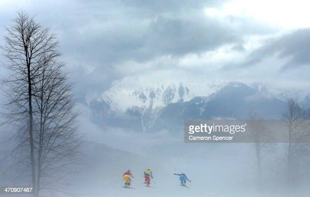 Anna Holmlund of Sweden Stephanie Joffroy of Chile and Katrin Ofner of Austria compete in heavy fog in the Freestyle Skiing Womens' Ski Cross Quarter...