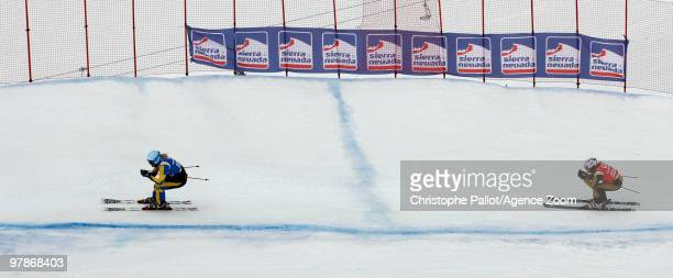 Anna Holmlund of Sweden takes 1st place Ophelie David of France takes 2nd place during the FIS Freestyle World Cup Women's Ski Cross on March 20 2010...