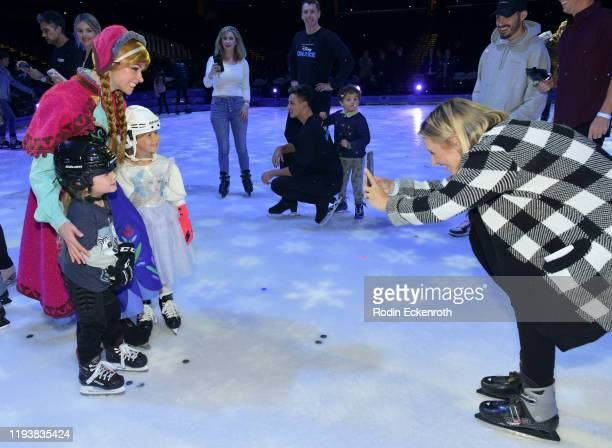 Anna Hutton Michael Cameron Kenzie Cameron and Beverely Mitchell at 2019 Disney On Ice Mickey's Search Party at Staples Center on December 13 2019 in...