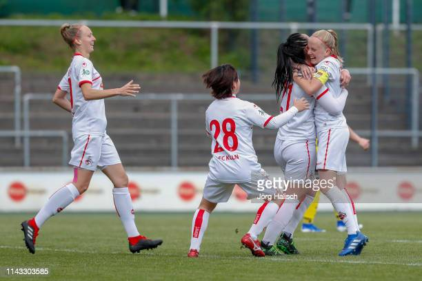 Anna Isabelle Linden Yuka Hirano and Peggy Nietgen and Anna Kirschbaum of Koeln celebrate their goal during the women's second Bundesliga match...