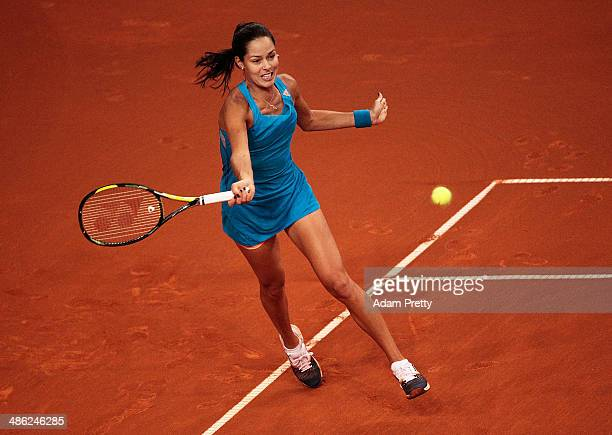 Anna Ivanovic of Serbia hits a forehand during her match against Sabine Lisicki of Germany during day 3 of the Porsche Tennis Grand Prix 2014 at...