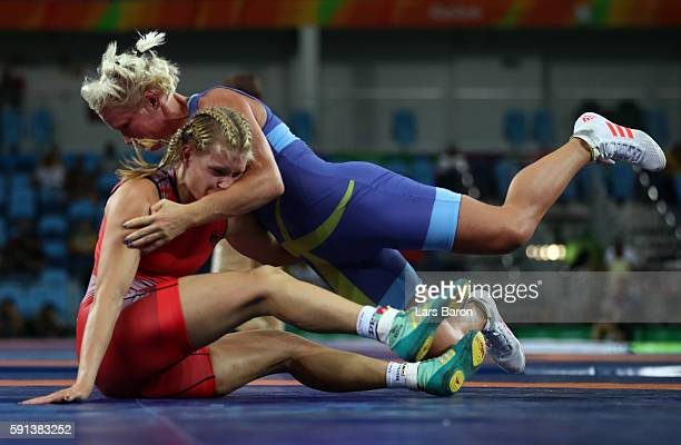 Anna Jenny Fransson of Sweden competes against Aline Focken of Germany during a Women's Freestyle 69kg Quarterfinal bout on Day 12 of the Rio 2016...