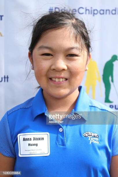 Anna Jiaxin Huang poses for a photo after finishing first overall in the girls 1011 competition during The Drive Chip and Putt Championship at...