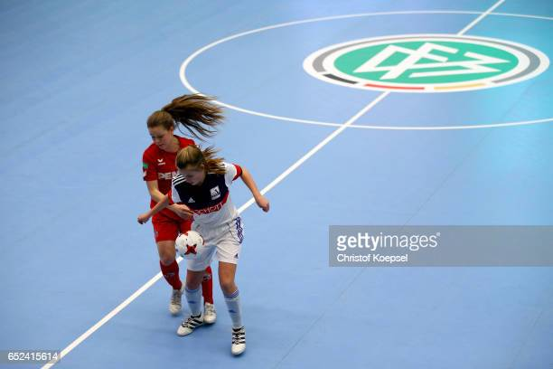 Anna Julia Grassinger of 1 FC Koeln challenges LisaMarie Rebholz of TSV Schott Mainz during the B Junior Girl's German Futsal Championship first...