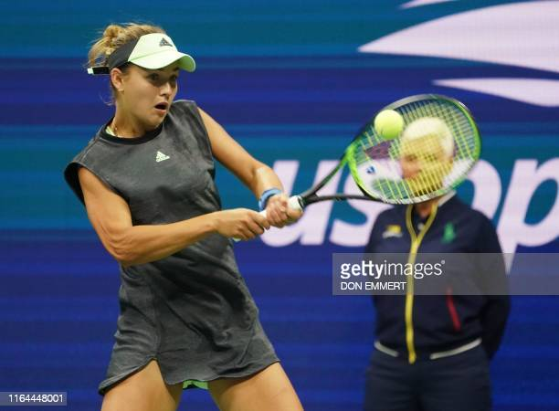 Anna Kalinskaya of Russia hits a return to Sloane Stephens during their first round match of the women's 2019 US Open tennis tournament at the USTA...
