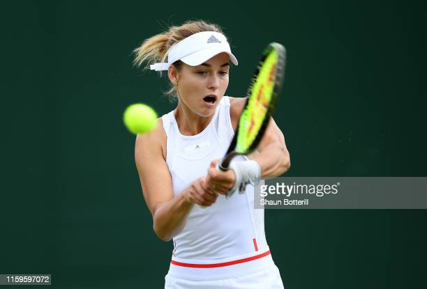Anna Kalinskaya of Russia plays a backhand in her Ladies' Singles first round match against Magda Linette of Poland during Day two of The...