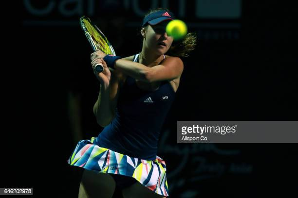 Anna Kalinskaya of Russia plays a backhand to Caroline Garcia of France during Round One of the 2017 WTA Malaysian Open at the TPC on February 28...