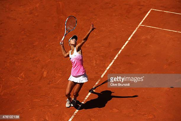 Anna Kalinskaya of Russia serves in the girl's singles final match against Paula Badosa Gibert of Spain on day fourteen of the 2015 French Open at...