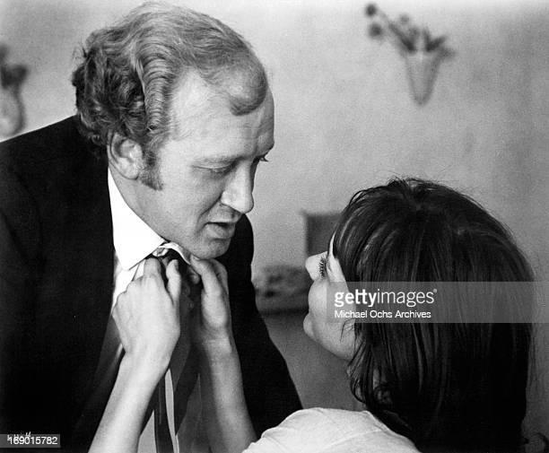 Anna Karina fixes Nicol Williamson neck tie in a scene from the film 'Laughter in the Dark' 1969