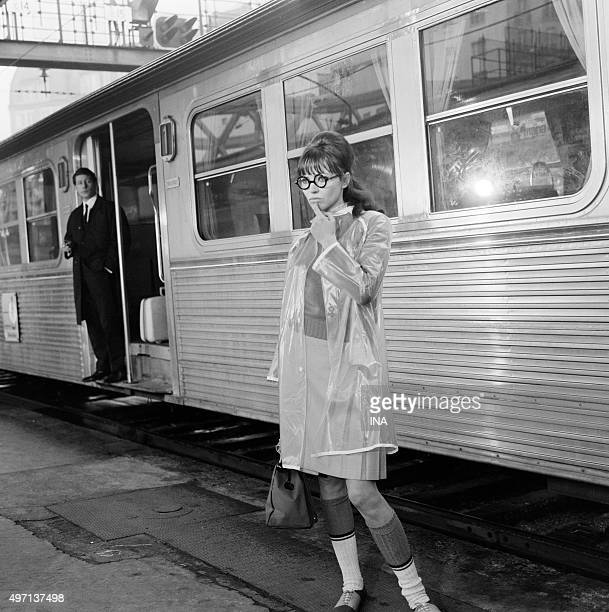 Anna Karina on the quay of a station in a scene of the musical 'Anna'