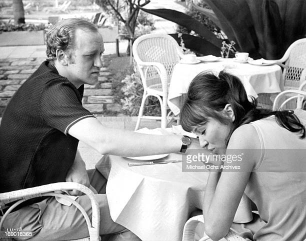 Anna Karina puts her face on Nicol Williamson's hand in a scene from the film 'Laughter in the Dark' 1969