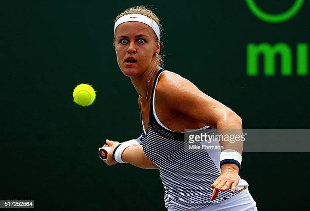 Anna Karolina Schmedlova of Slovakia plays a match against Madison Brengle during Day 4 of the Miami Open presented by Itau at Crandon Park Tennis...