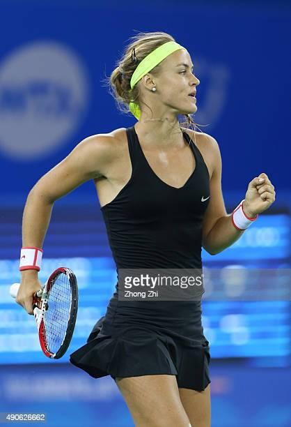 Anna Karolina Schmiedlova of Slovakia reacts after winning the match against Kristina Mladenovic of France on Day 4 of 2015 Dongfeng Motor Wuhan Open...