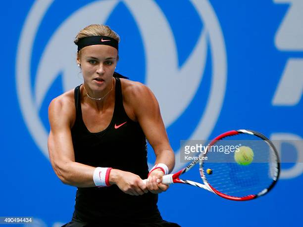 Anna Karolina Schmiedlova of Slovakia returns a shot to Caroline Wozniacki of Denmark during her match in day 3 of 2015 Dongfeng Motor Wuhan Open at...