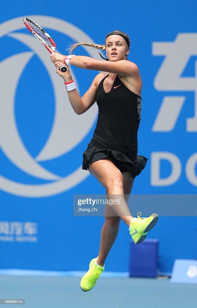 Anna Karolina Schmieiidlova of Slovakia returns a shot during the match against Caroline Wazniacki of Denmark on Day 3 of 2015 Dongfeng Motor Wuhan Open at Optics Valley International Tennis Center on September 29, 2015 in Wuhan, China.