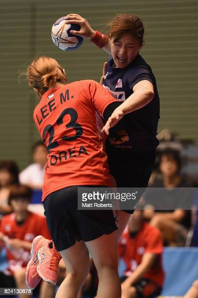 Anna Kawamura of Japan is challenged by Lee Migyeong of South Korea during the women's international match between Japan and South Korea at Komazawa...