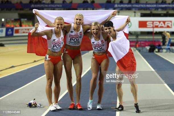 Anna Kielbasinska Iga BaumgartWitan Malgorzata HolubKowalik and Justyna SwietyErsetic of Poland celebrate winning gold in the final of the women's...