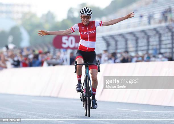 Anna Kiesenhofer of Team Austria celebrates winning the gold medal during the Women's road race on day two of the Tokyo 2020 Olympic Games at Fuji...