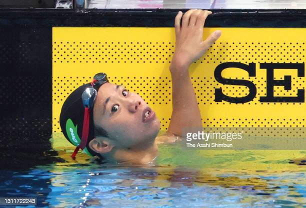 Anna Konishi reacts after competing in the Women's 200m Backstroke final on day seven of the 97th Japan Swimming Championships at the Tokyo Aquatics...