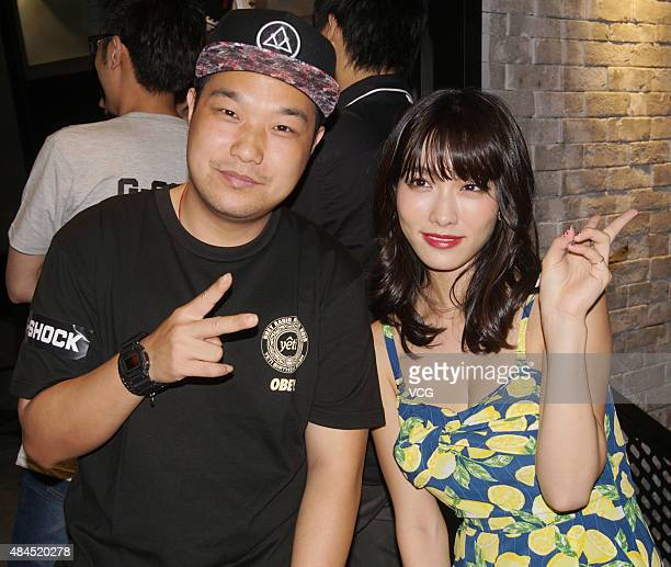 Anna Konno Japanese gravure idol from Kanagawa Prefecture poses with a man while attending a commercial activity on August 19 2015 in Shanghai China