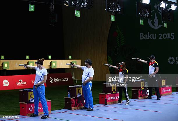 Anna Korakaki and Konstantinos Malgarinos of Greece and Monika Karsch and Christian Reitz of Germany compete in the Mixed Team 10m Air Pistol Final...