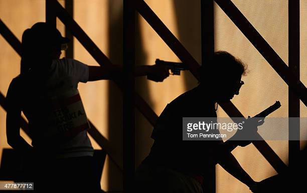 Anna Korakaki of Greece and Irada Ashumova of Azerbaijan shoot during the Women's Pistol Shooting 25m Rapid on during day eight of the Baku 2015...