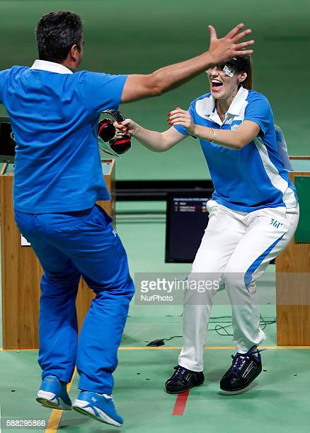 Anna Korakaki of Greece celebrates with her coach also her father after the women's 25m pistol final of shooting at the 2016 Rio Olympic Games in Rio...