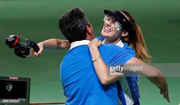 Anna Korakaki of Greece hugs with her coach also her father after the women's 25m pistol final of shooting at the 2016 Rio Olympic Games in Rio de...