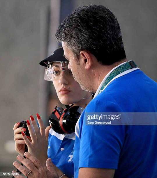 Anna Korakaki of Greece speaks with her coach during the 25m Pistol competition on Day 4 of the Rio 2016 Olympic Games at the Olympic Shooting Centre...