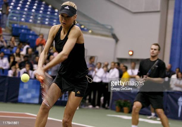 Anna Kournikova and Andy Roddick at the Advanta WTT Smash Hits tennis event at the Bren Center at UC Irvine in Irvine California on September 14 2006