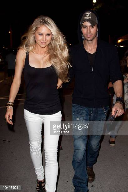 Anna Kournikova and Enrique Iglesias leave the Orange Carpet for the Miami Dolphins versus New York Jets game at Sun Life Stadium on September 26...