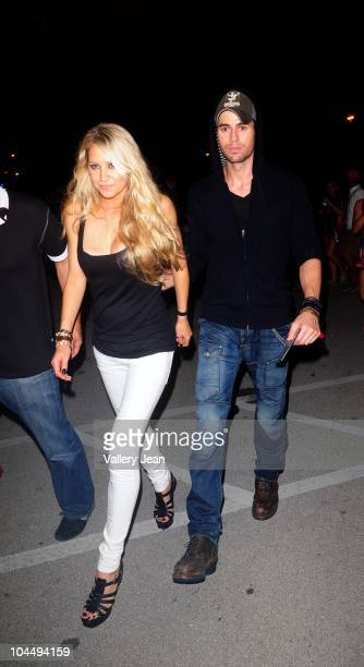 Anna Kournikova and Enrique Iglesias leaving the Miami Dolphins versus New York Jets game at Sun Life Stadium on September 26 2010 in Miami Florida