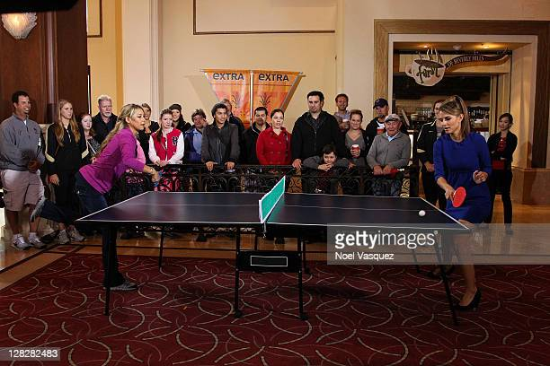Anna Kournikova and Maria Menounos play ping pong at Extra at The Grove on October 5 2011 in Los Angeles California