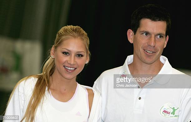Anna Kournikova and Tim Henman pose for a photograph at the Ariel Tennis ACE Finals Day on May 22 2006 in London England Anna Kournikova has teamed...