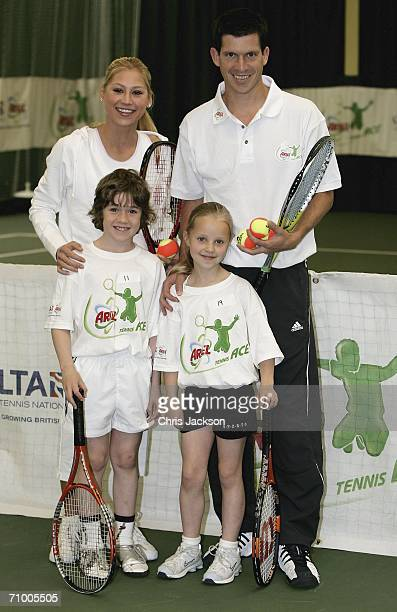 Anna Kournikova and Tim Henman pose with Harry Price and Liza Welch at the Ariel Tennis ACE Finals Day on May 22 2006 in London England Harry and...