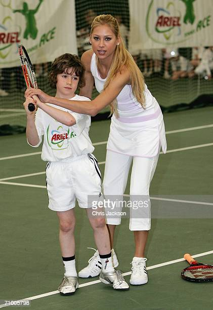 Anna Kournikova coaches Harry Price who has made it through to the final from five regional heats at the Ariel Tennis ACE Finals Day on May 22 2006...
