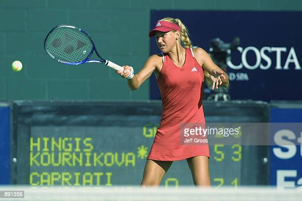 Anna Kournikova eyes her forehand return against Arantxa SanchezVicario and Jennifer Capriati during the match at the Acura Classic at La Costa...