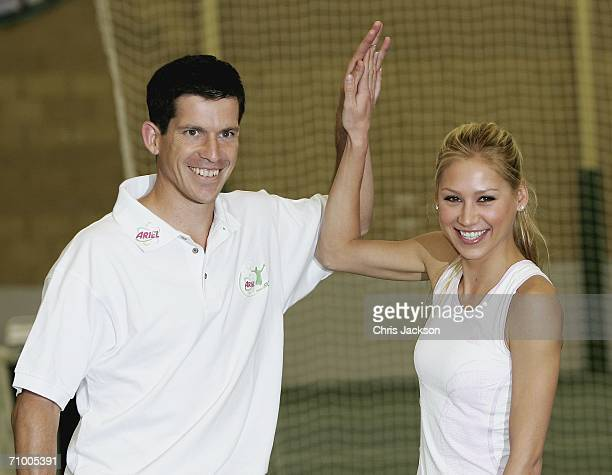 Anna Kournikova highfives with Tim Henman at the Ariel Tennis ACE Finals Day on May 22 2006 in London England Anna Kournikova has teamed up with Tim...