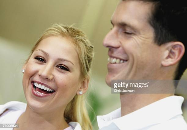 Anna Kournikova laughs next to Tim Henman as they talk to the press at the Ariel Tennis ACE Finals Day on May 22 2006 in London England Anna...