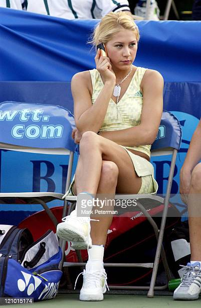 Anna Kournikova made a phone call while her teammates warmed up before her only home match playing World Team Tennis for the Kansas City Explorers on...