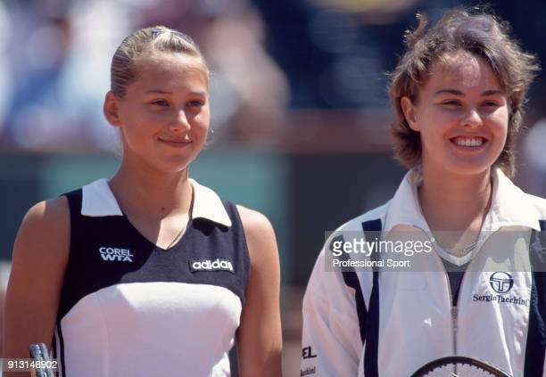 Anna Kournikova of Russia and Martina Hingis of Switzerland pose together before a match during the French Open Tennis Championships at the Stade...