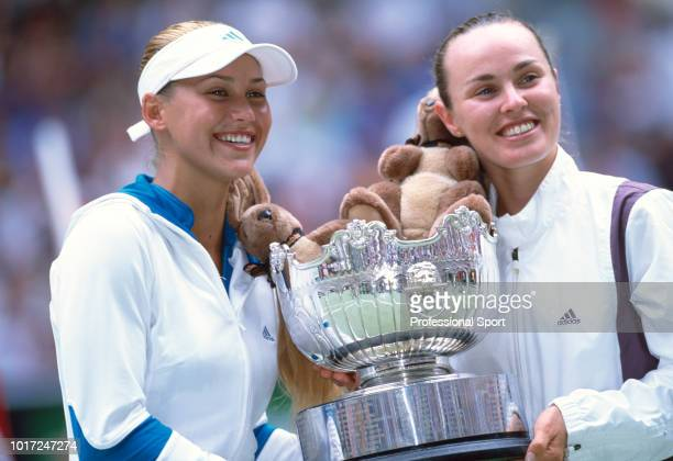 Anna Kournikova of Russia and Martina Hingis of Switzerland pose with the trophy after defeating Daniela Hantuchova of Slovakia and Arantxa Sanchez...